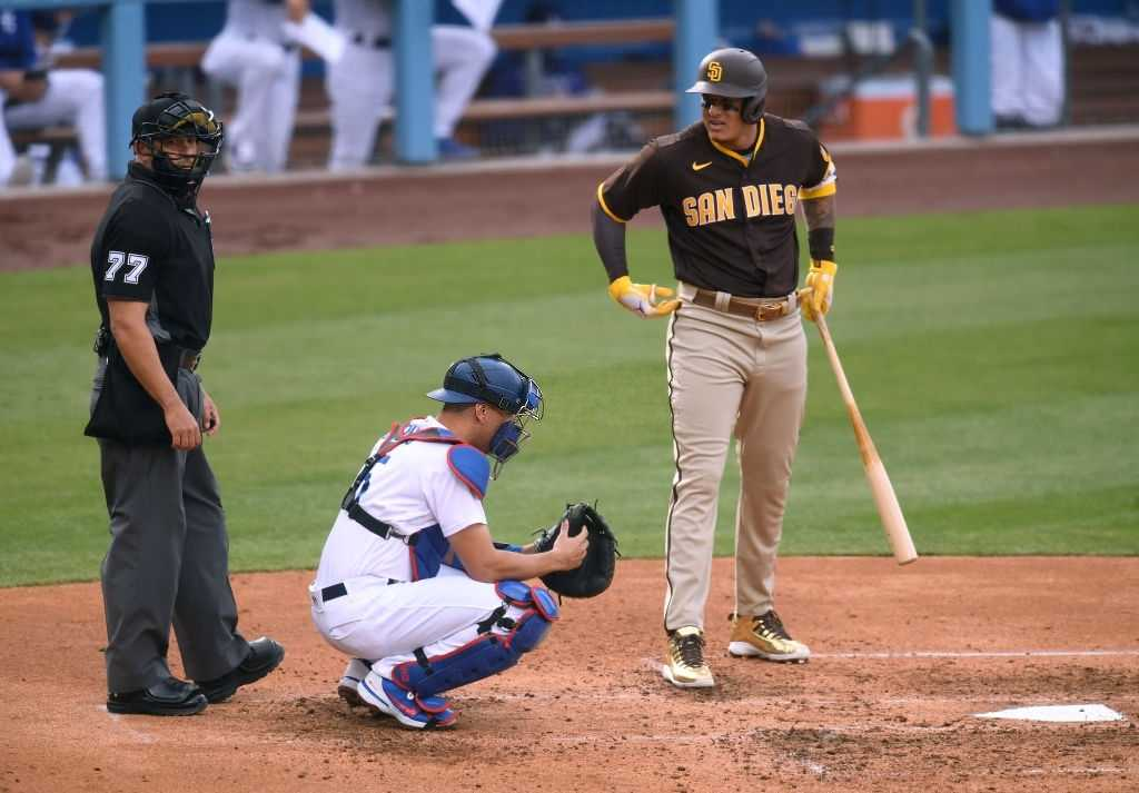 Manny Machado #13 of the San Diego Padres reacts to a call from umpire