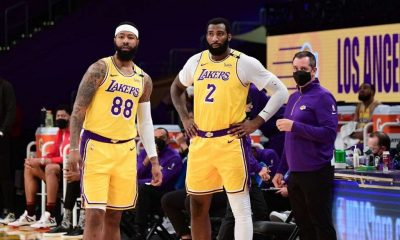 Markieff Morris #88, Andre Drummond #2 and Head Coach Frank Vogel of the Los Angeles Lakers stand on the sidelines during the game