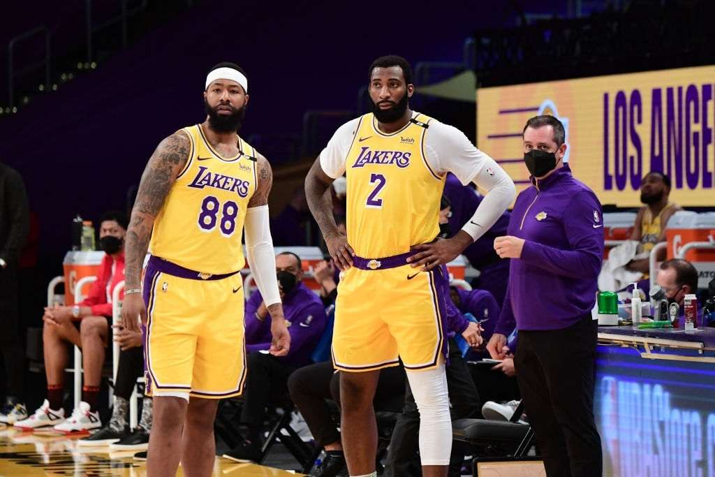 Markieff Morris #88, Andre Drummond #2 and Head Coach Frank Vogel of the Los Angeles Lakers Defense stand on the sidelines during the game