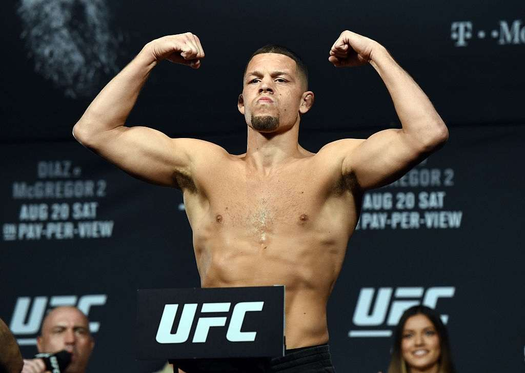 Mixed martial artist Nate Diaz poses on the scale during his weigh-in for UFC 202 at MGM Grand Conference Center on August 19, 2016