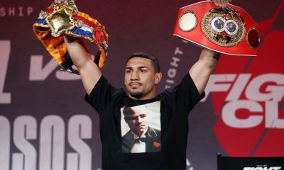 Teofimo Lopez poses with his championship belts during a press conference for Triller Fight Club at Mercedes-Benz Stadium on April 16, 2021