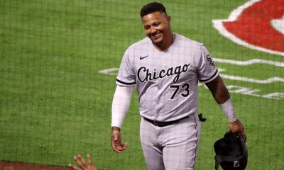 Yermin Mercedes #73 of the Chicago White Sox celebrates his RBI double with third base coach Joe McEwing #47 against the Los Angeles Angels