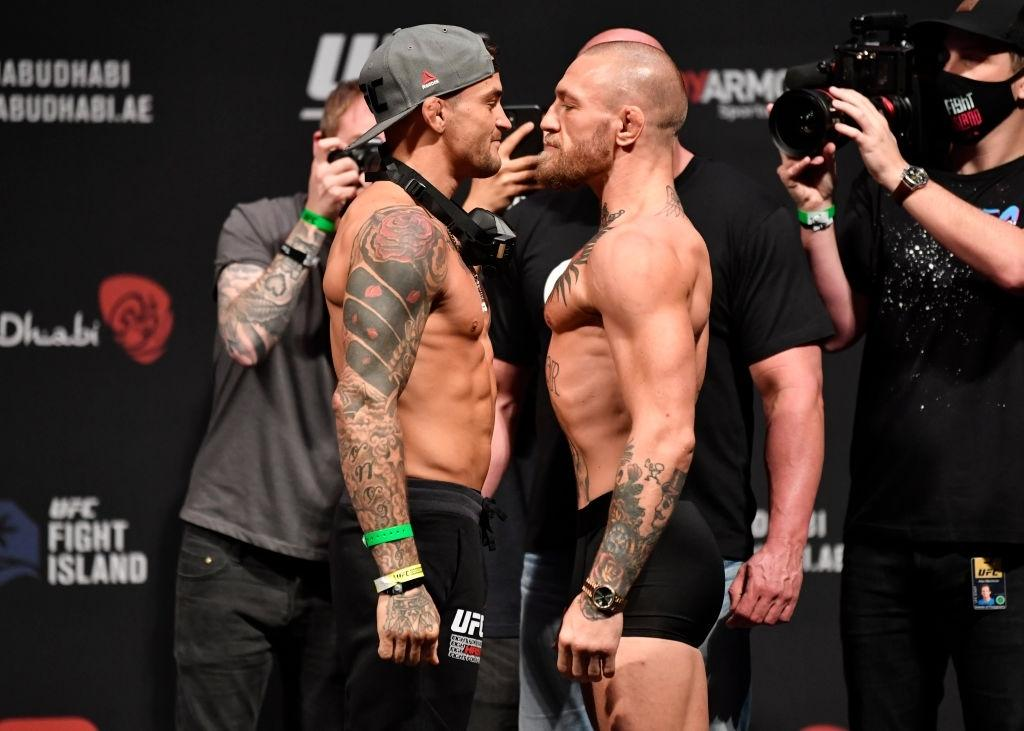 Opponents Dustin Poirier and Conor McGregor of Ireland face off during the UFC 257 weigh-in.