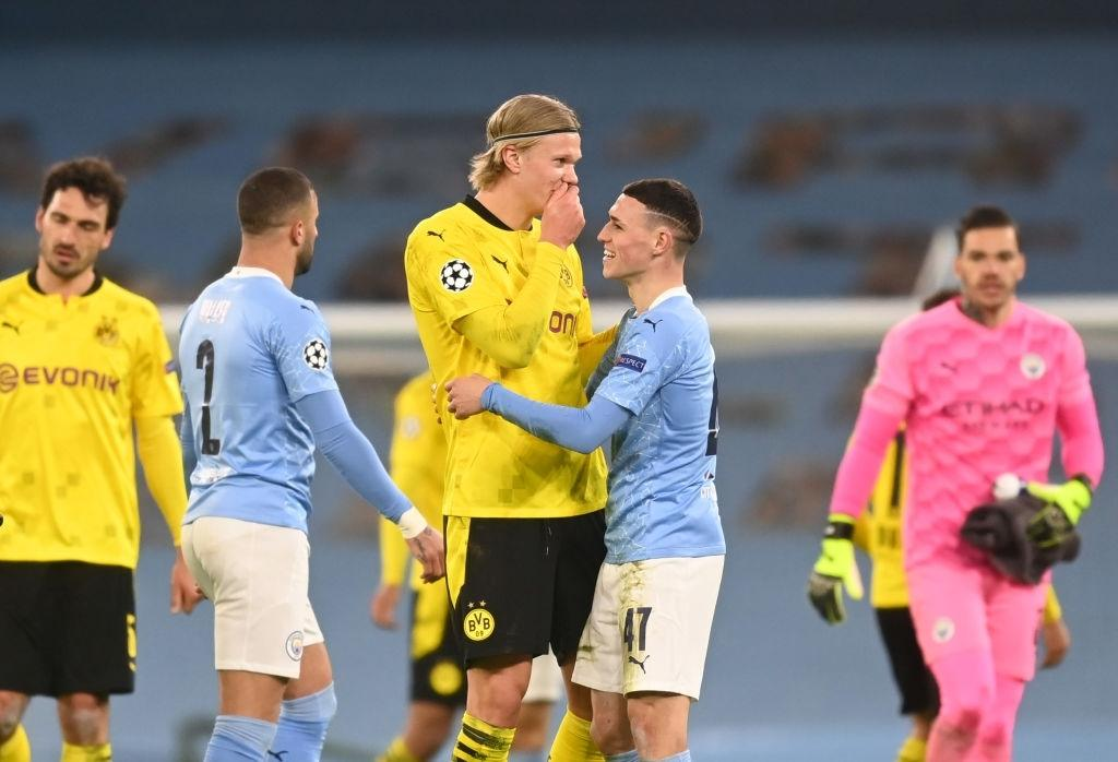Phil Foden of Manchester City and Erling Haaland of Borussia Dortmund interact (Photo by Michael Regan/Getty Images)