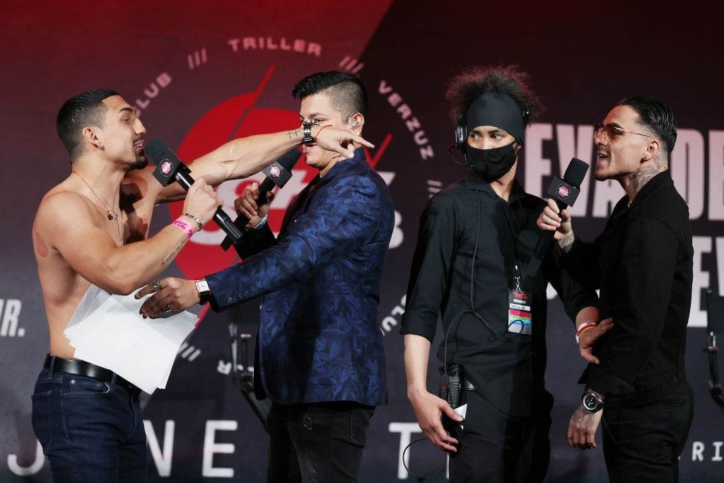 Teofimo Lopez and George Kambosos Jr. face off during a press conference for Triller Fight Club at Mercedes-Benz Stadium on April 16, 2021 in Atlanta, Georgia ahead of their June 5 lightweight title fight.