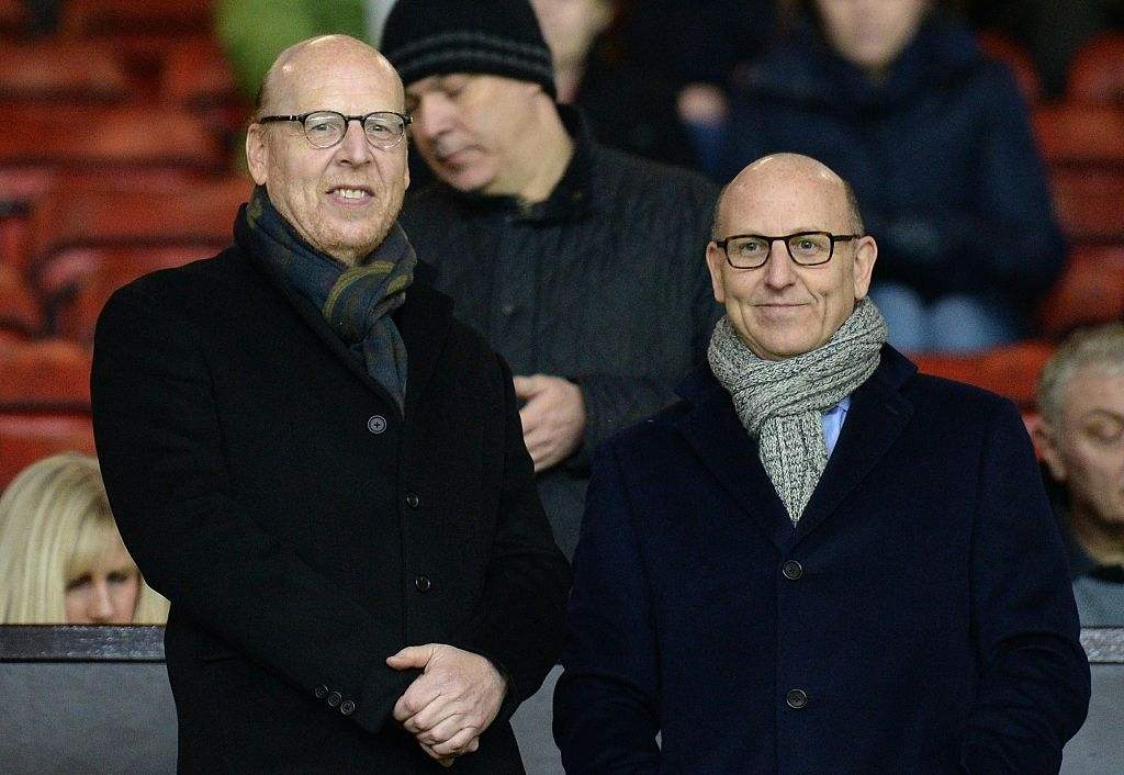 Manchester United's co-chairmen Joel Glazer and Avram Glazer (L) (Photo credit should read OLI SCARFF/AFP via Getty Images)