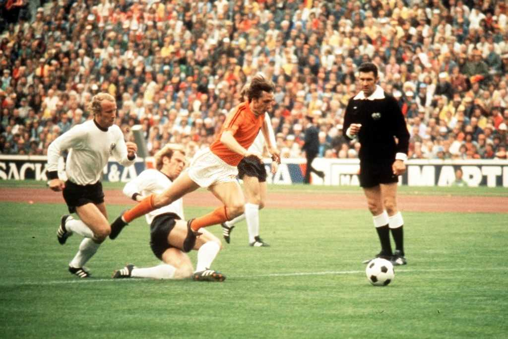 1974: Johan Cruyff of Holland jumps a tackle from Uli Hoeness of West Germany during the 1974 World Cup Final. Mandatory Credit: Allsport UK/ALLSPORT