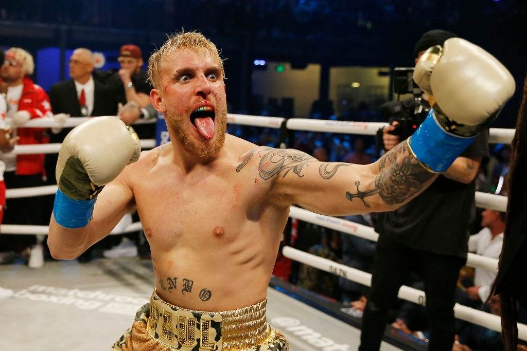 Jake Paul celebrates after defeating AnEsonGib in a first round knockout.