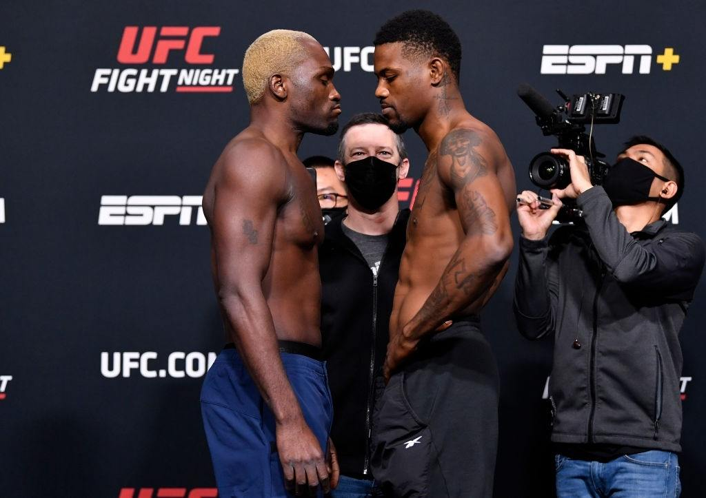 Opponents Derek Brunson and Kevin Holland face off during the UFC weigh-in at UFC APEX on March 19, 2021 in Las Vegas, Nevada.