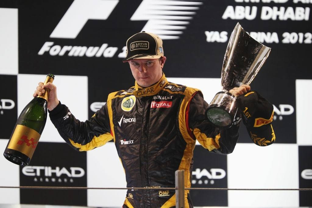 Kimi Raikkonen celebrates at the podium after a well deserved win.