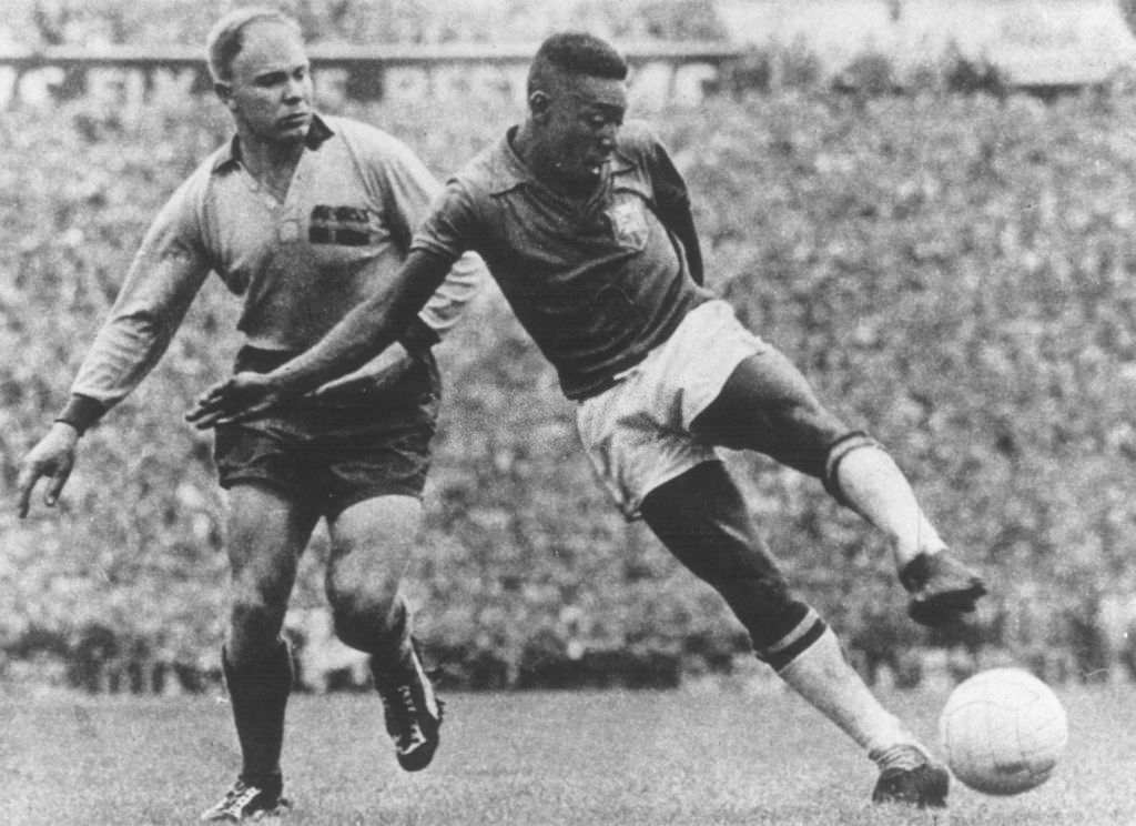 Brazil's Pele shoots as he is challenged by a Swedish defender (Photo by Popperfoto via Getty Images/Getty Images)