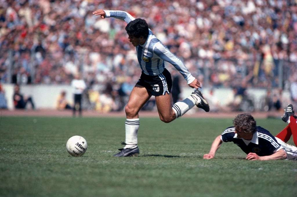 Top ten Greatest Footballers: Diego Maradona keeps his balance as he takes the ball past the fallen Paul Hegarty.. (Photo by Mark Leech/Getty Images)