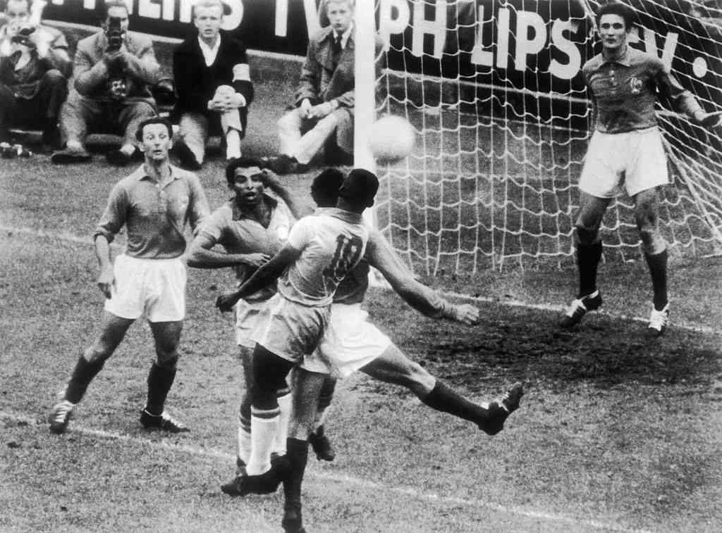 The Brazilian forwards VAVA and PELE struggling with the French defense