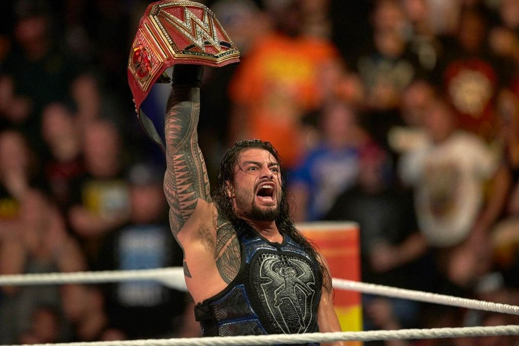 Roman Reign enters the ring with his belt (Photo by Rob Tringali /Sports Illustrated via Getty Images)