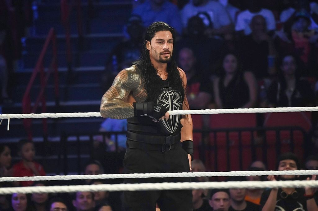 Roman Reigns looks on (Photo by Ron ElkmanSports Imagery/Getty Images)