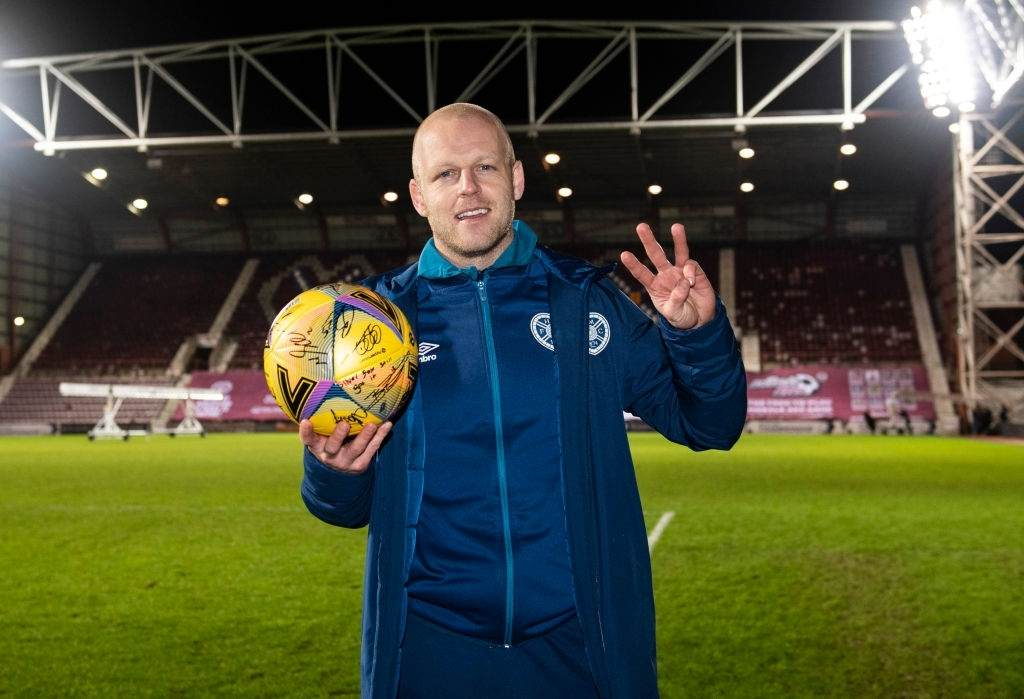 Hearts' Steven Naismith with the match ball (Photo by Paul Devlin/SNS Group via Getty Images)