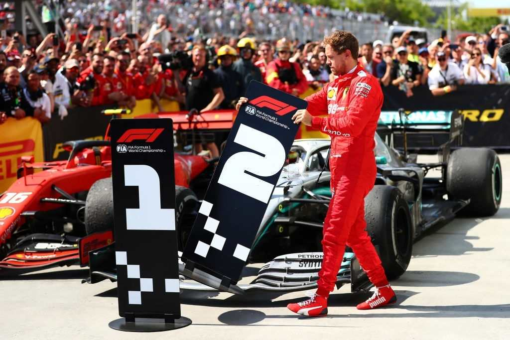 Sebastian Vettel is seen changing the number boards after the results.