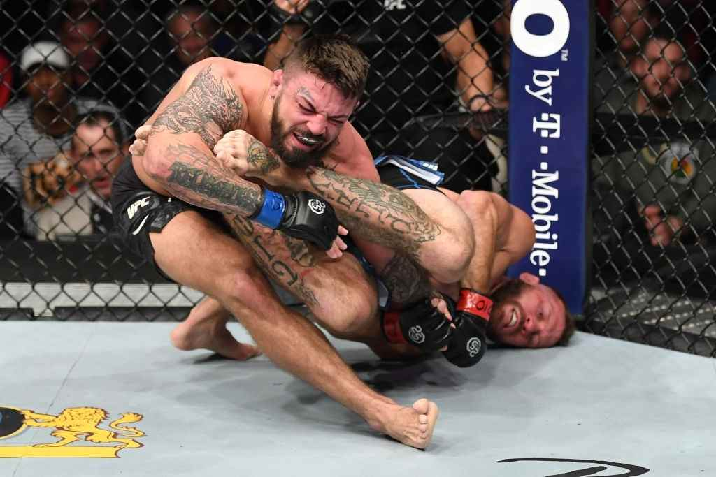 Donald Cerrone attempts to submit Mike Perry in their welterweight bout during the UFC Fight Night event inside Pepsi Center on November 10, 2018 in Denver, Colorado.