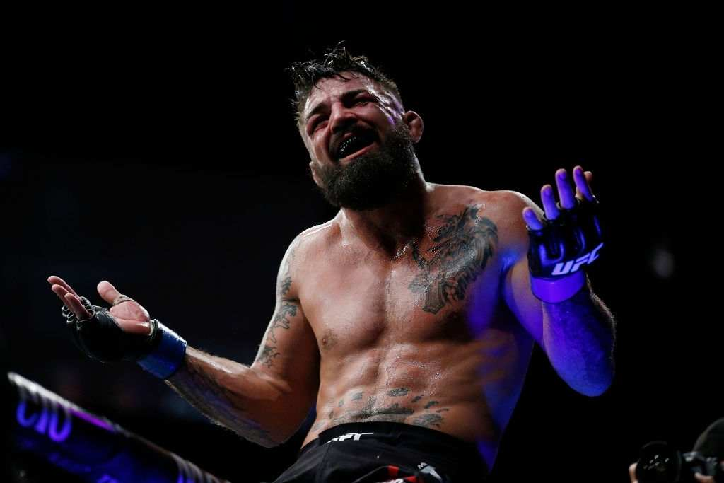 Mike Perry celebrates after defeating Alex Oliveira of Brazil during their welterweight bout at UFC Fight Night at BB&T Center on April 27, 2019 in Sunrise, Florida.
