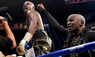 Floyd Mayweather Jr. and Floyd Mayweather Sr. celebrate after defeating Conor McGregor during their super welterweight boxing match on August 26, 2017 at T-Mobile Arena in Las Vegas, Nevada.