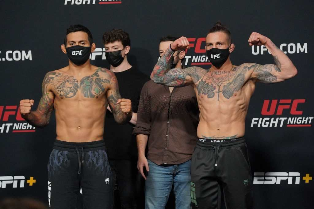 Diego Ferreira (left) and Gregor Gillespie (right) face-off in front of the press during UFC Fight Night | Vegas 26 : Rodriguez vs Waterson at UFC Apex on May 7, 2021 in Las Vegas, NV.