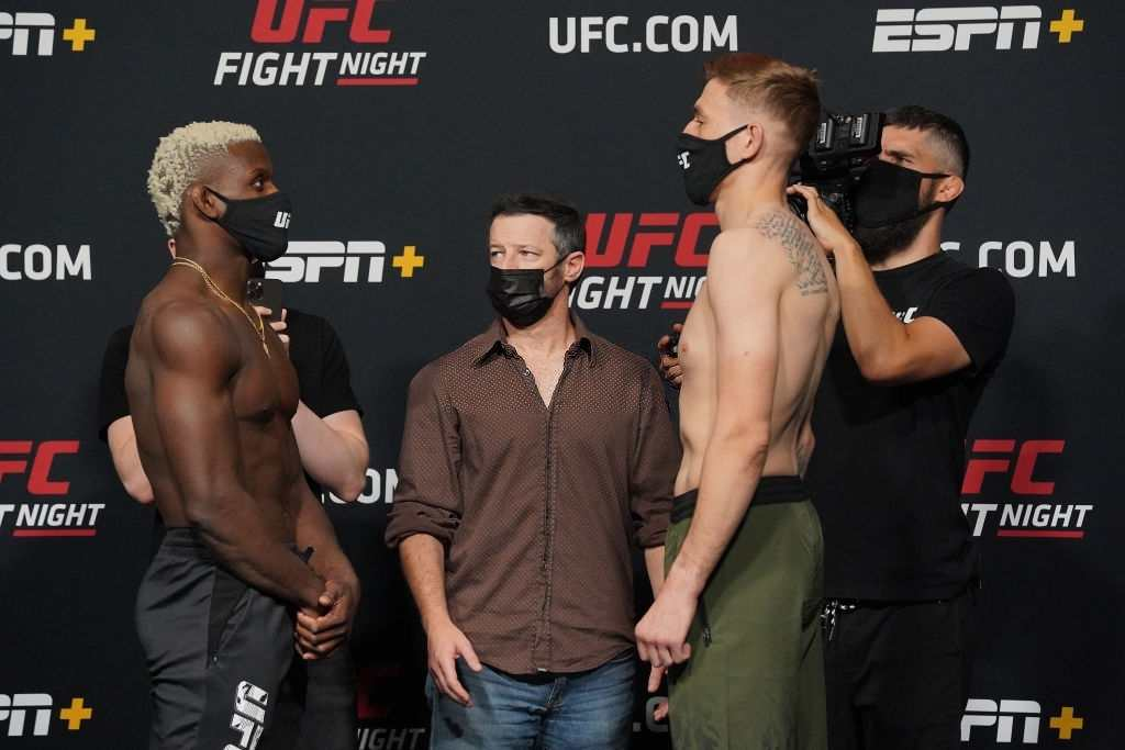 Phil Hawes and Kyle Daukaus face-off in front of the press during UFC Fight Night | Vegas 26 : Rodriguez vs Waterson at UFC Apex on May 7, 2021 in Las Vegas, NV.