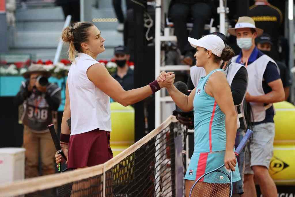 Aryna Sabalenka interacts with Ashleigh Barty following the womens single final match between Aryna Sabalenka and Ashleigh Barty on Day Ten of the Mutua Madrid Open at La Caja Magica on May 08, 2021 in Madrid, Spain. (Photo by Clive Brunskill/Getty Images)
