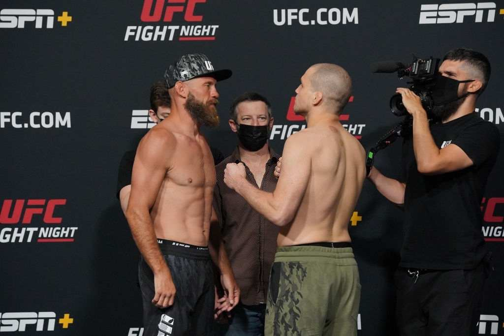 Donald Cowboy Cerrone (left) and Alex Morono (right) face-off in front of the press during UFC Fight Night   Vegas 26 : Rodriguez vs Waterson at UFC Apex on May 7, 2021 in Las Vegas, NV.