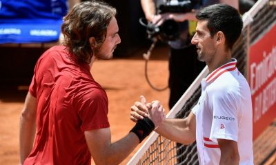 Serbia's Novak Djokovic (R) taps hands with Greece's Stefanos Tsitsipas after winning their quarter final match of the Men's Italian Open at Foro Italico on May 15, 2021 in Rome, Italy.
