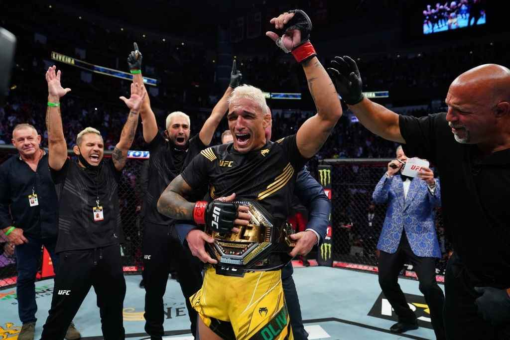Charles Oliveira of Brazil reacts as UFC President Dana White places the UFC lightweight championship belt around his waist after defeating Michael Chandler at Toyota Center on May 15, 2021 in Houston, Texas.