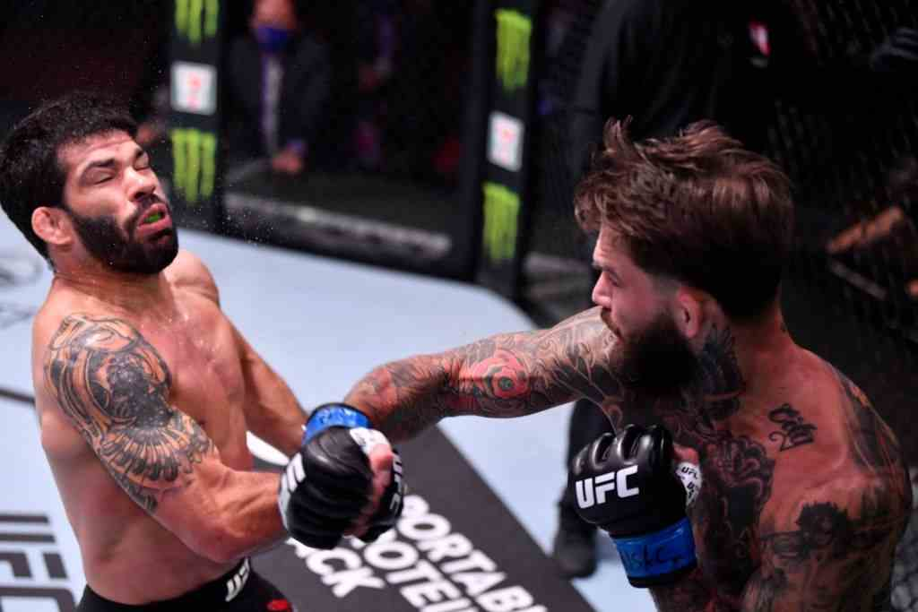 Cody Garbrandt punches Raphael Assuncao of Brazil in their bantamweight bout during the UFC 250 event at UFC APEX on June 06, 2020 in Las Vegas, Nevada.