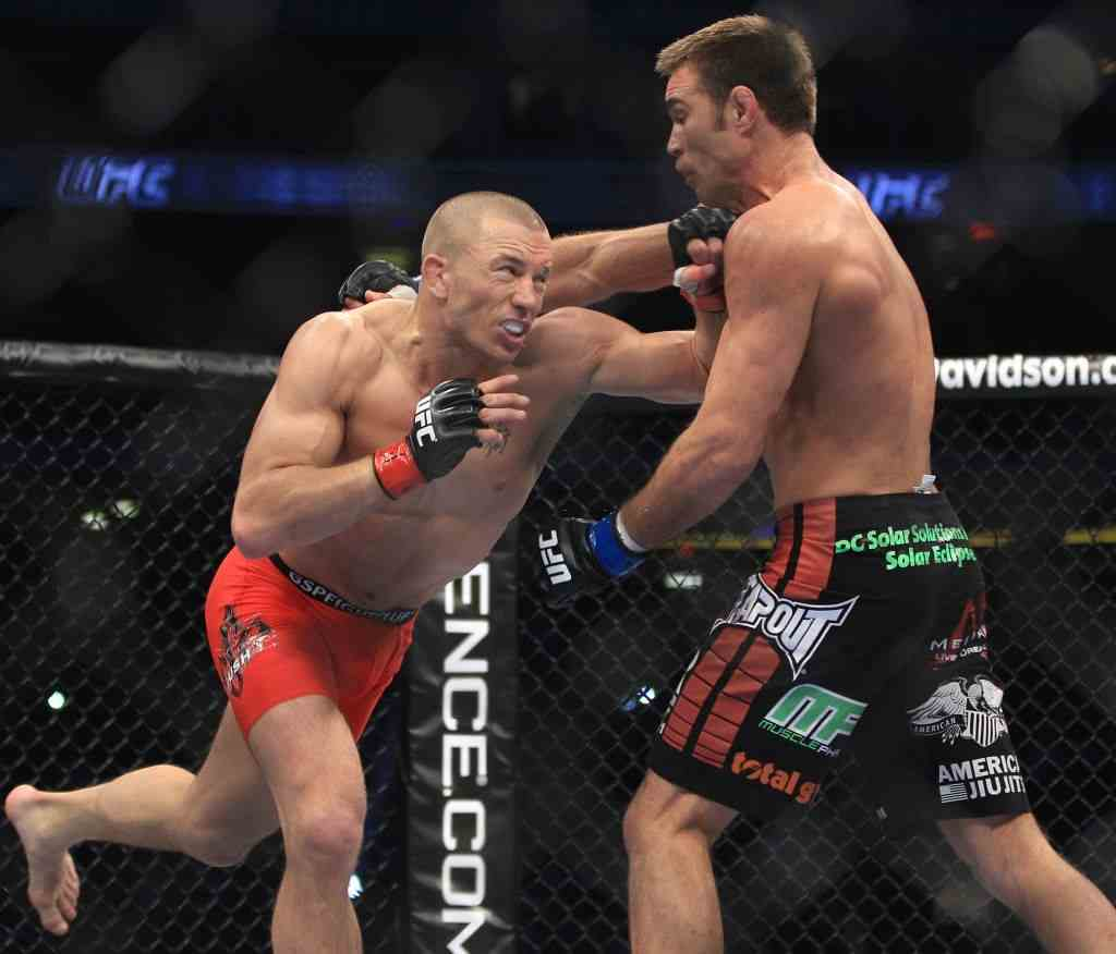 George St Pierre of Montreal throws the superman left on Jake Sheilds of California at UFC 129 .