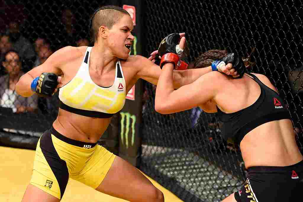 Amanda Nunes of Brazil punches Miesha Tate in their UFC women's bantamweight championship bout during the UFC 200 event at T-Mobile Arena on July 9, 2016 in Las Vegas, Nevada