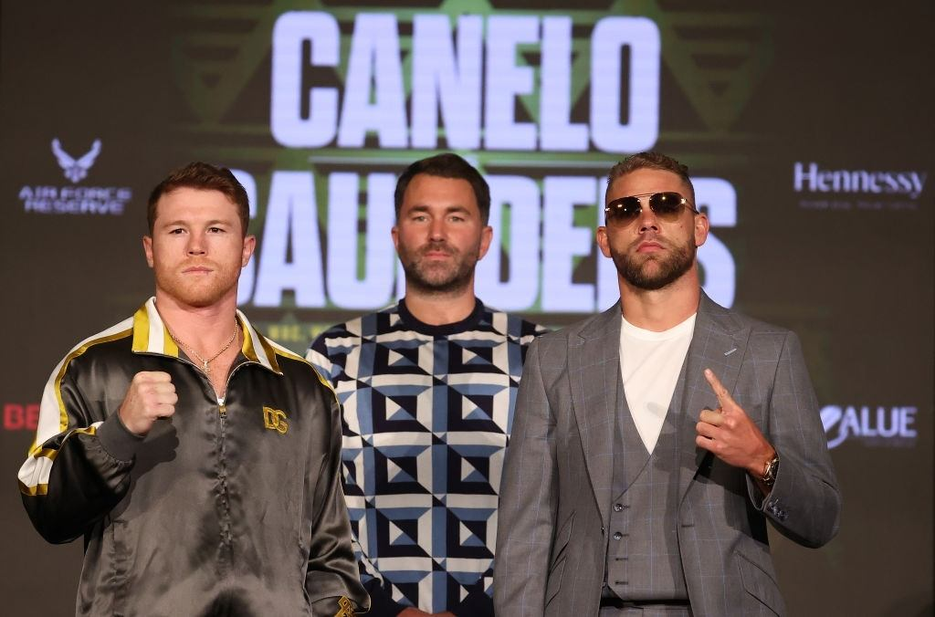 Canelo Alvarez and Billy Joe Saunders face off with Matchroom Promoter Eddie Hearn looking on during the press conference.