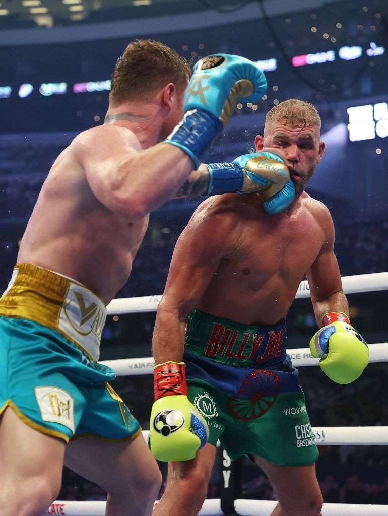 Canelo Alvarez punches Billy Joe Saunders during their fight.