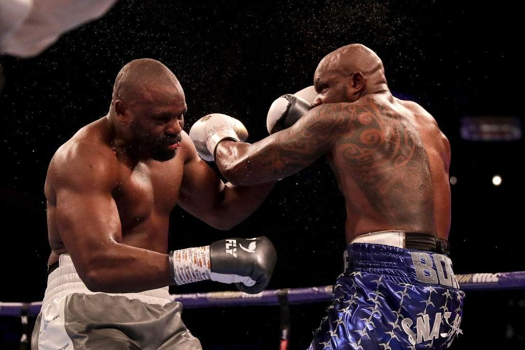 Dillian Whyte (r) knocks out Dereck Chisora to win the Heavyweight fight.