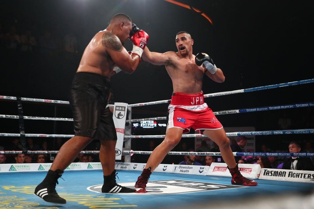 Justis Huni punches Faiga Opelu during their Australia Heavy Weight Title bout.