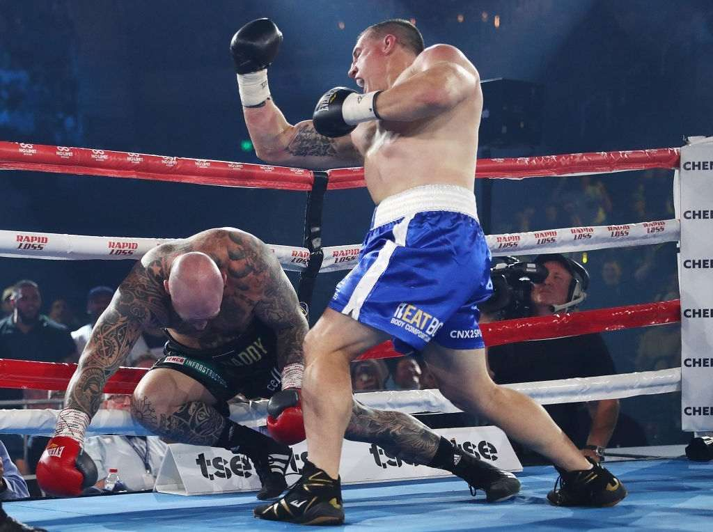 Paul Gallen punches Lucas Browne during their bout at WIN Entertainment Centre.