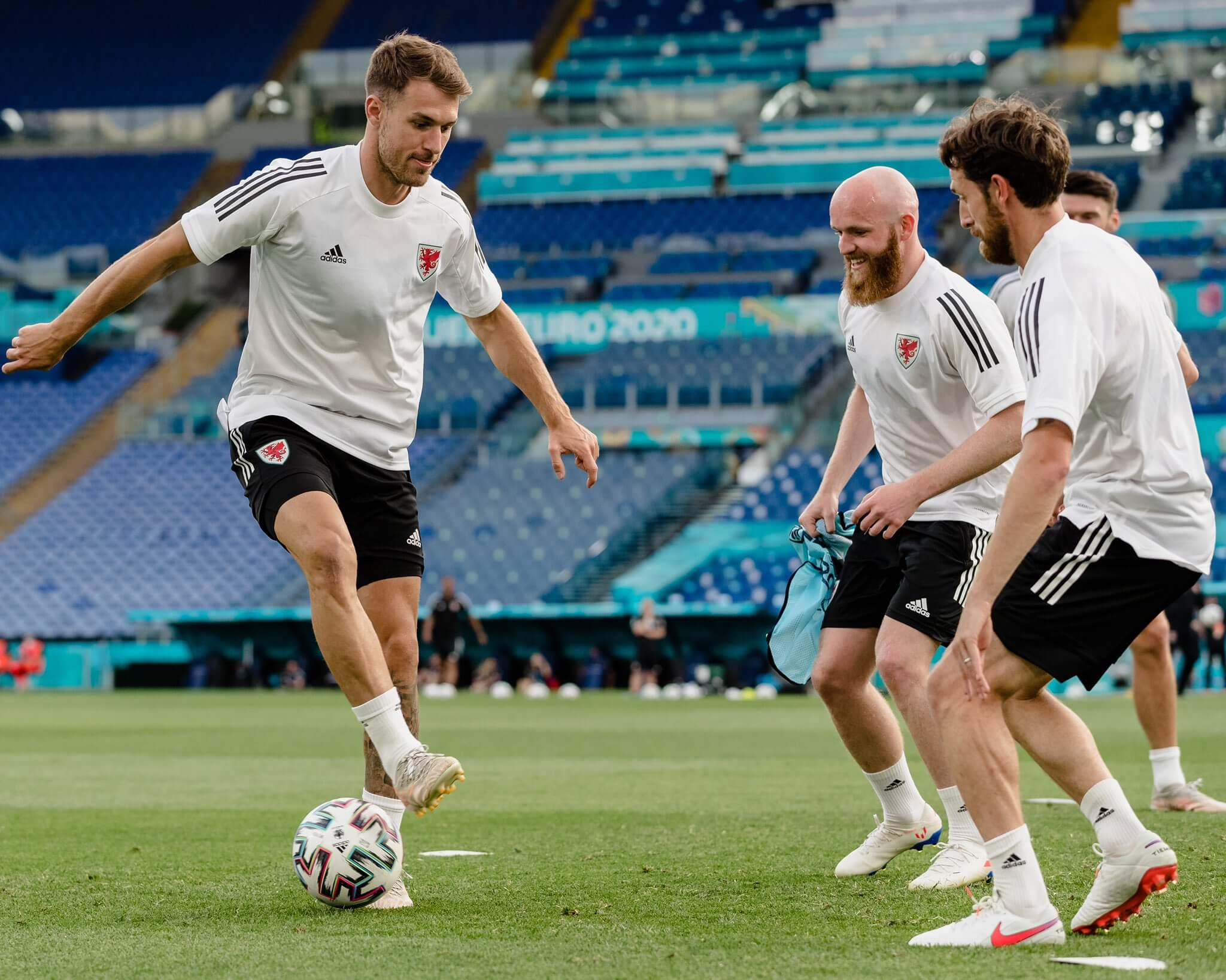 Wales players practicing before their match against Italy
