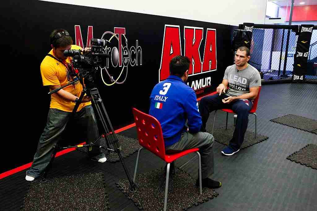 UFC fighter Cain Velasquez is interviewed by Univision during his media day workout at American Kickboxing Academy to promote his October 19, title fight with Junior dos Santos on October 10, 2013 in San Jose, California.