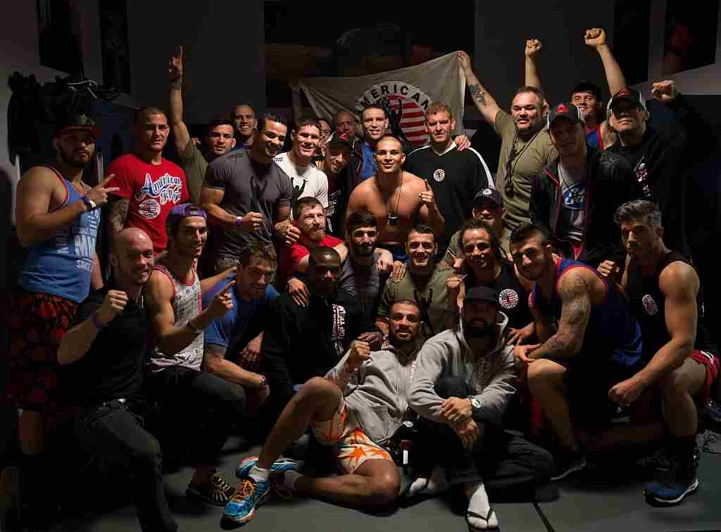 Hayder Hassan celebrates his TKO victory over Andrews Nakahara with his team during the filming of The Ultimate Fighter: American Top Team vs Blackzilians on February 10, 2015 in Boca Raton, Florida