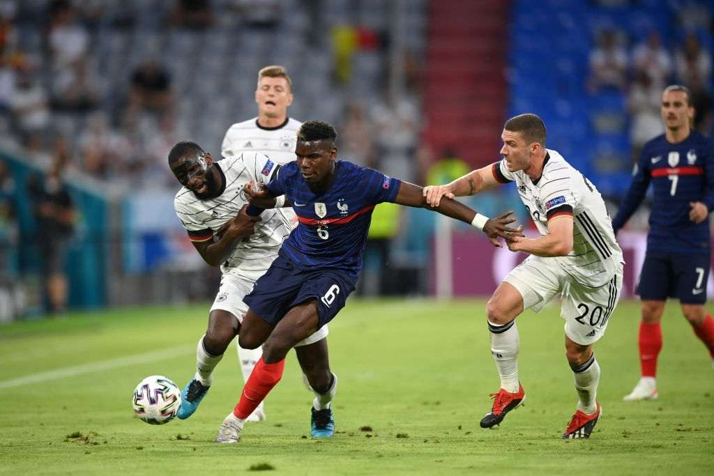 Paul Pogba of France battles for possession with Antonio Ruediger and Robin Gosens of Germany during the UEFA Euro 2020